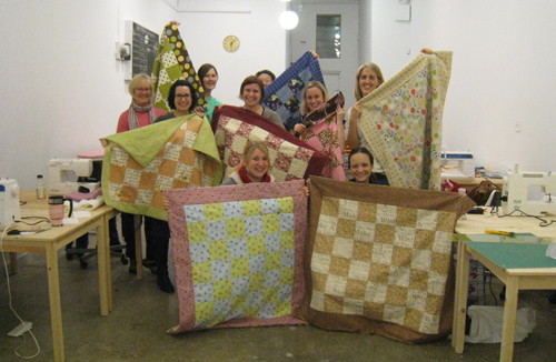 Class of completed quilts