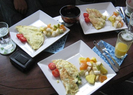 Christmas Breakfast - omelettes and fruit salad