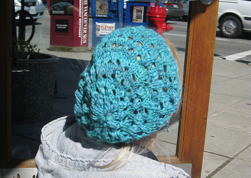Slouchy handknit hat made with handspun, hand-dyed yarn. Lotsa hands!