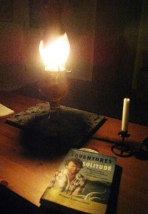 Reading 'Adventures in Solitude' by kerosene lamplight on Savary Island