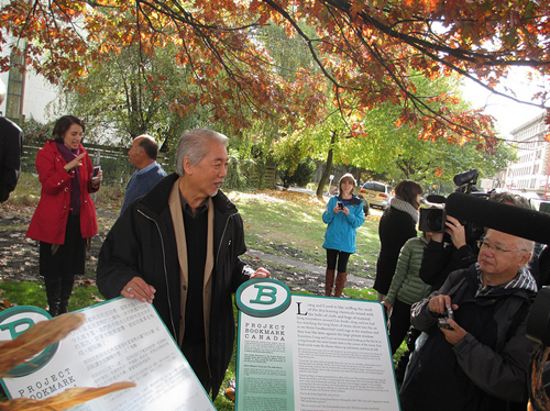 Wayson Choy with the 'Jade Peony' Bookmarks (Chinese on the left, English on the right)