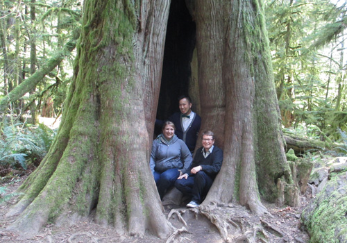 Three of Us inside a tree, Cathedral Grove, Vancouver Island